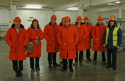 Members of the Scottish Region, in suitable attire, being shown round the Brakes Distribution Centre by Alan Brown, the Distribution Centre Manager (far right).