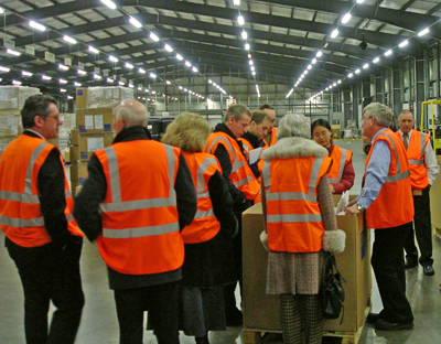 Members being shown round the DHL Mossend facility during the visit.