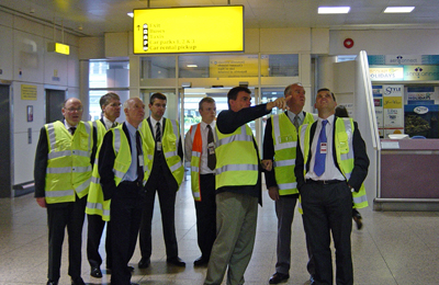 Richard Watson, Terminal Manager explaining how the airport information system works to members during the tour of the Glasgow Airport Terminal building.