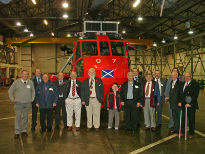 Members of the Scottish Region party in front of one of HMS Gannet's Sea King HU Mk. 5 helicopters.