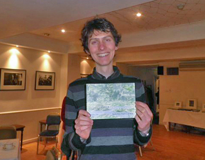 Leo du Feu, landscape painter with one of his works.