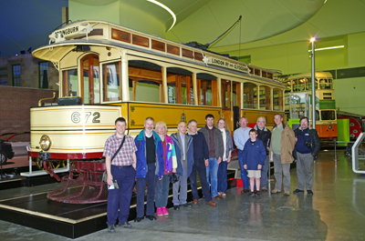 CILT members pose in front of Glasgow Corporation Transport tram 672 inside the new museum.