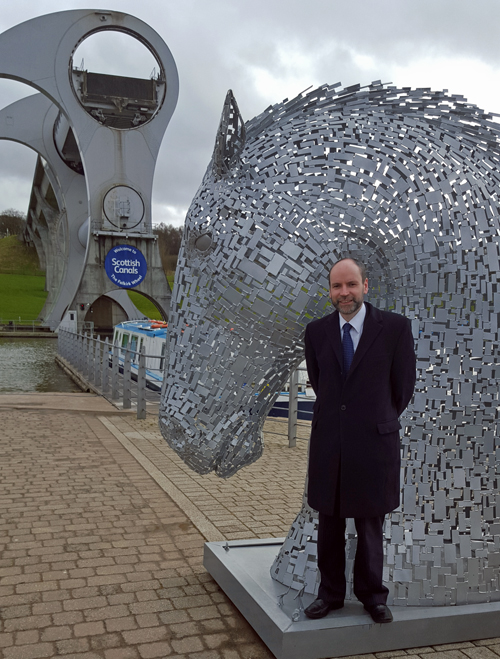 Richard Millar with the Falkirk Wheel and a Kelpie.