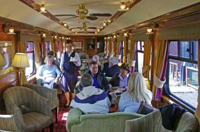 Scottish Region members and guests enjoying afternoon tea in the observation car.<