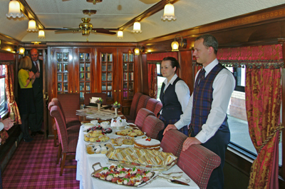 The interior of dining car one with a range of sandwiches, scones and cakes ready for members and guests.