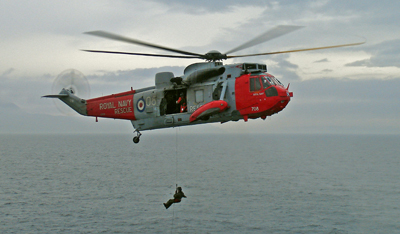 A Royal Navy Sea King HAS 5 rescue helicopter hovering alongside the MV Caledonian Isles.