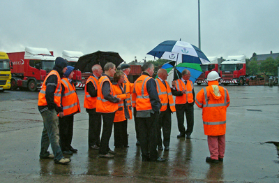 Kay Walls (centre) explaining the detailed workings of Freightliner Intermodal's Coatbridge Container Terminal to Scottish Region members during the tour of the facility in the rain.