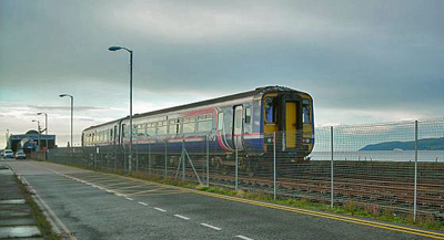 A Scotrail train arriving at Stranraer with Cairnryan visible in the distance.