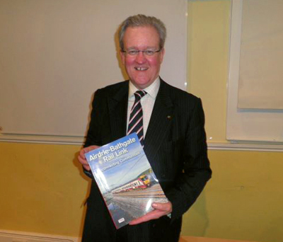 Stewart Stevenson MSP with a copy of the Airdrie - Bathgate Rail Link book.