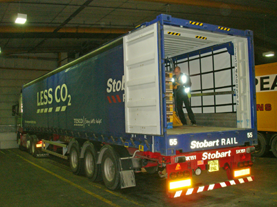 The first container that was transported by rail to Grangemouth, then by road to Dundee, being unloaded in the Distribution Centre.